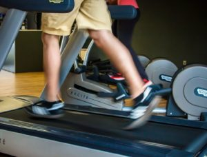 A close up of someone running on a treadmill
