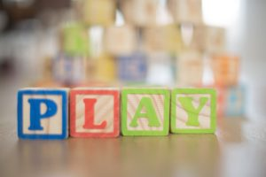 Childrens blocks, spelling out the word 'play'