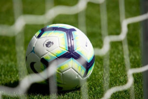 A close up of a football in a goal net
